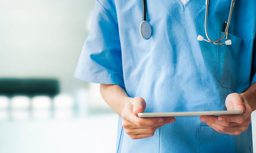 Doctor holding a tablet