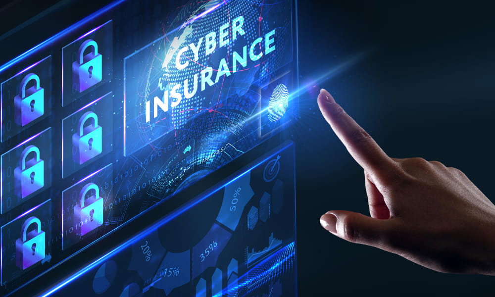 Person pointing a digital design of the words cyber insurance