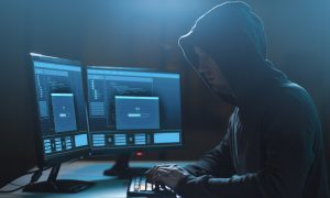 hacker planning ransomware attack on computer