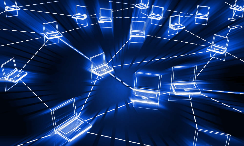 computers being connected symbolizing the importance of cybersecurity