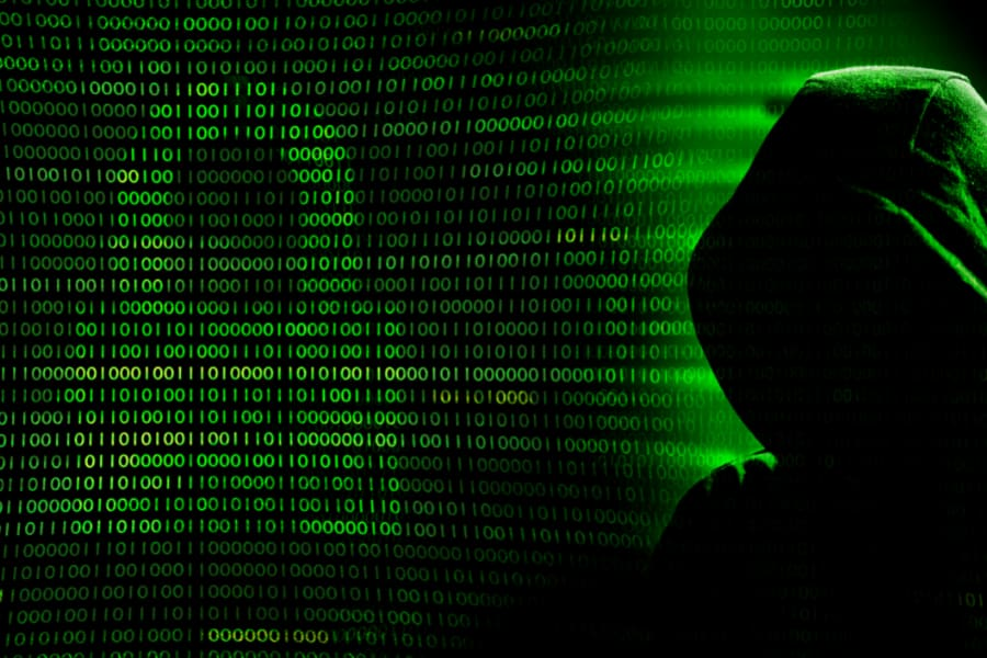 Hacker preparing for cybersecurity attack impacting companies